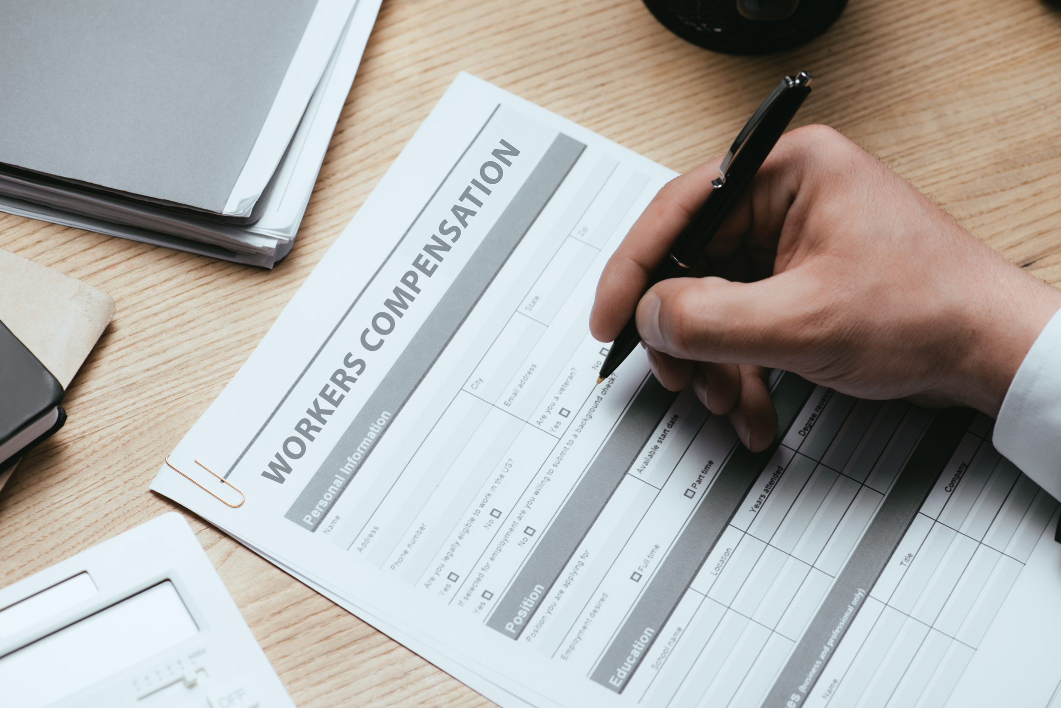 man filling out workers compensation form