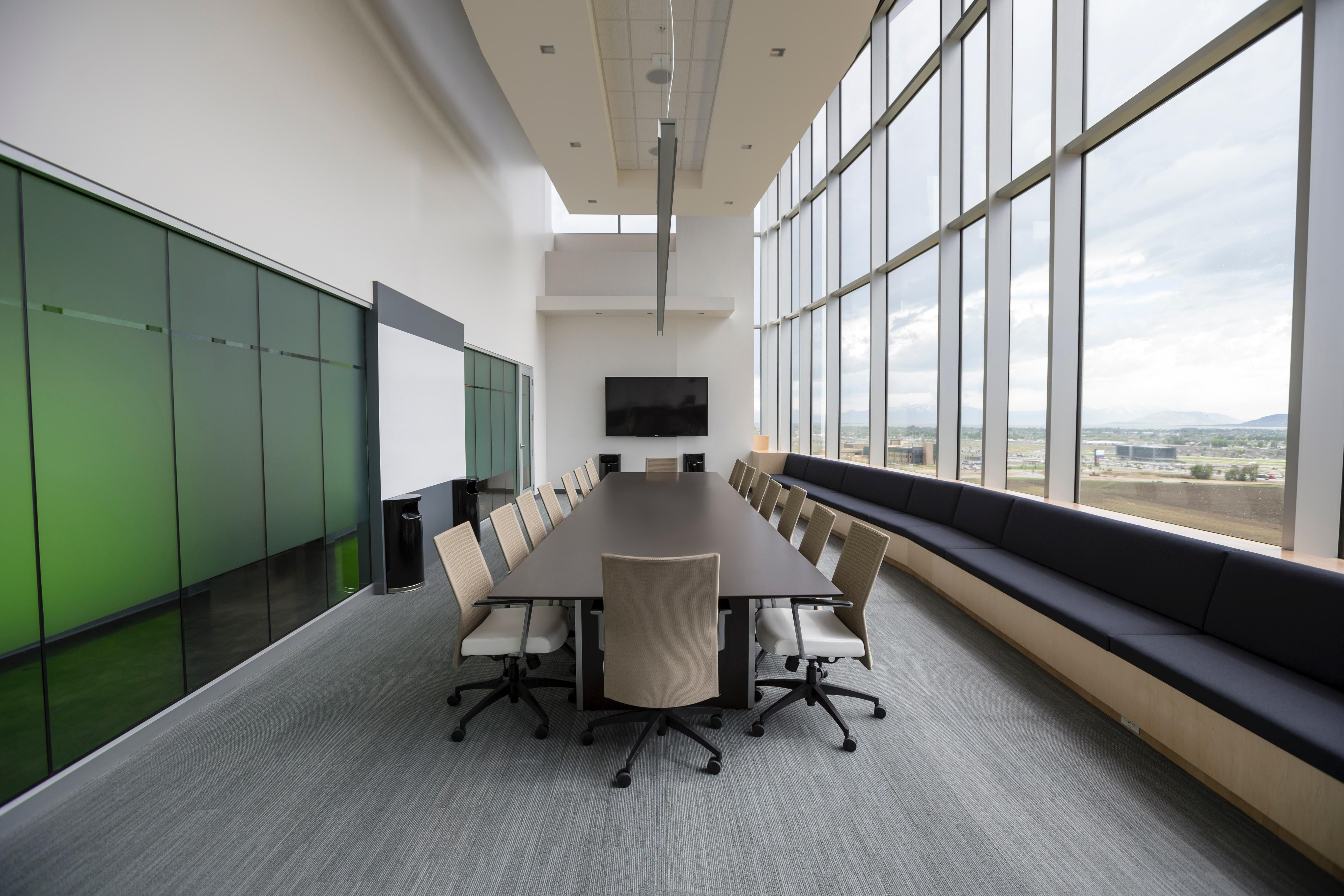 commercial building with brown conference table in the center of the floor